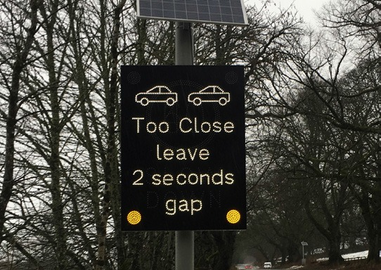 Alerting drivers to adjust their speed through dynamic signage 1